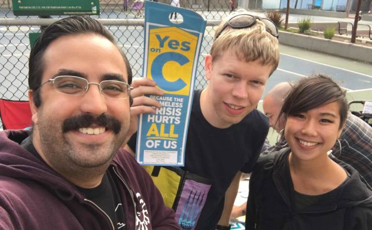 yimby housing activists canvassing with door hangers for a bond to fund homelessness services
