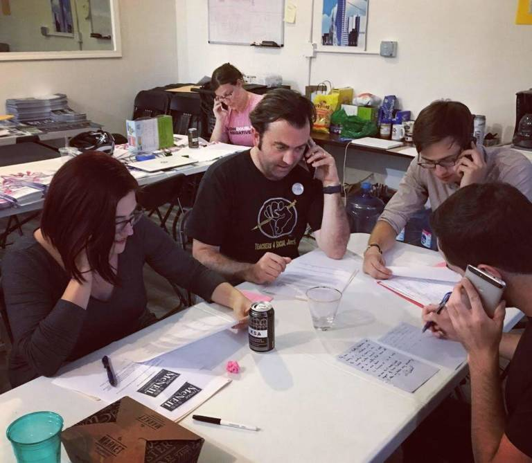 YIMBYs sitting around a table phone banking for an election